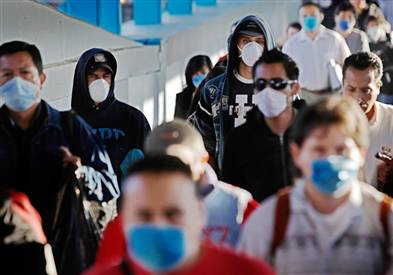 an image of people walking down the street with flu masks